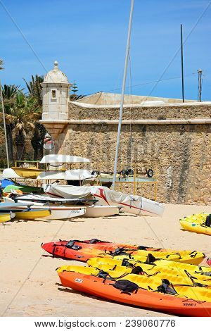 Lagos, Portugal - June 9, 2017 - View Of The Ponta Da Bandeira Fort With Canoes On The Beach In The