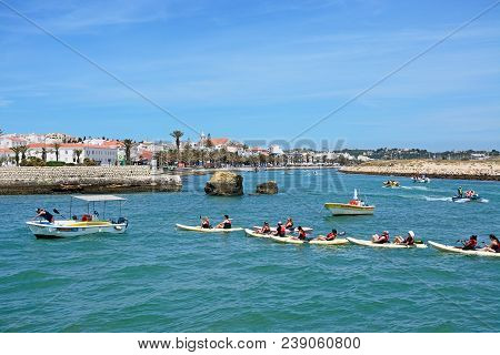 Lagos, Portugal - June 9, 2017 - Tourists In Canoes On The River Bansafrim With Views Towards The To