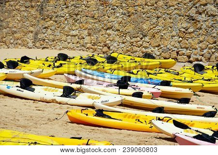 Lagos, Portugal - June 9, 2017 - Colourful Kayaks On The Beach, Lagos, Algarve, Portugal, Europe, Ju