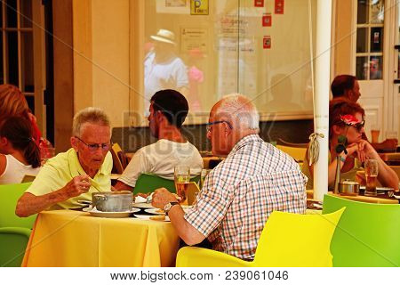 Lagos, Portugal - June 9, 2017 - Tourists Having Lunch At A Pavement Restaurant Along The R 25 De Ab
