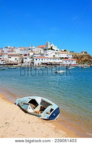 Ferragudo, Portugal - June 10, 2017 - View Of The White Town With Boats Moored On The River Arade, F