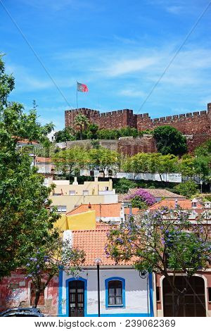 Silves, Portugal - June 10, 2017 - City Buildings With The Medieval Castle To The Rear, Silves, Port