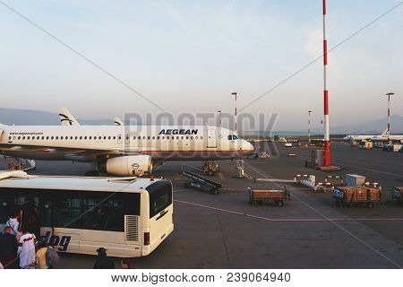 Greece, Athens, April 2018. Modern Passenger Airliner On The Lane During The Service. Passengers Of