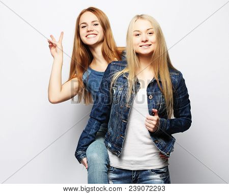 Emotions, People, Teens And Friendship Concept - Two Beautiful Young Teen Girl Giving Victory Hand S
