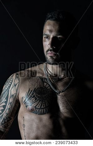 Macho With Sexy Bare Torso. Bearded Man With Tattooed Chest. Fit Model With Tattoo Art On Skin. Spor