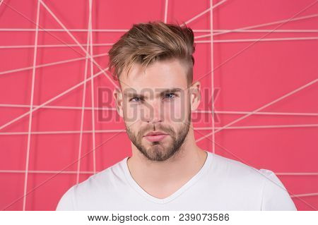 Macho With Beard On Unshaven Face. Bearded Man With Blond Hair And Stylish Haircut. Handsome Guy Wit
