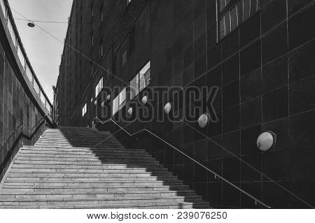 A Stairway In The City Of Stockholm, Sweden, In Black And White With Artistic Low-key Light And Shad