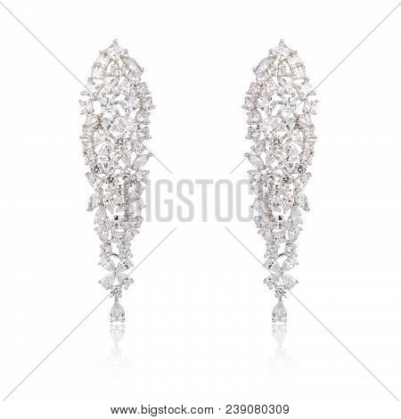 Pair Of Silver Diamond Earrings Isolated On White