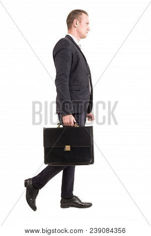 Businessman Walking And Holding A Briefcase Isolated On White Background