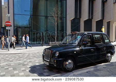 London, Great Britain, April 20, 2018 : Hackney Carriage Or Black Cab. In The United Kingdom, The Na