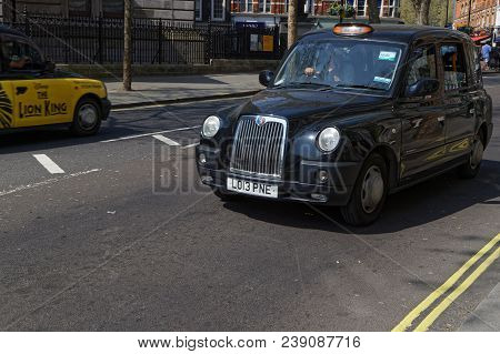 London, Great Britain, April 21, 2018 : Hackney Carriage Or Black Cab In The Streets Of London. In T