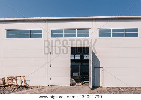 Large Industrial Warehouse Or Storehouse Exterior With Open Gates, Exterior