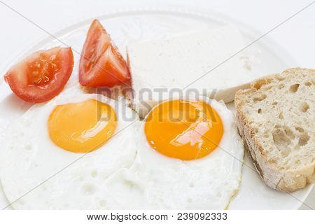 Fried Eggs With Cheese, Bred And Tomatoes