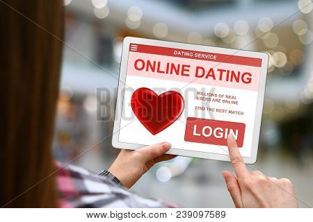 Online Dating Concept, Girl Holds The Digital Tablet On Blurred Mall Background