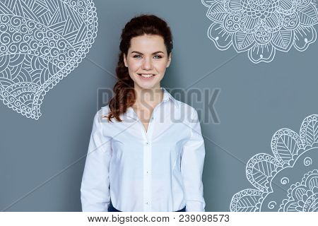 Happy Secretary. Cheerful Emotional Young Secretary Smiling And Feeling Happy While Waiting For Her
