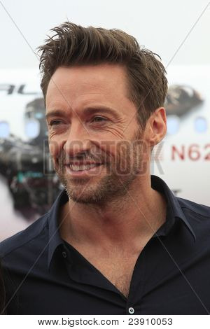 LOS ANGELES - SEPT 23:  Hugh Jackman arrives as Virgin America unveils new DreamWorks 'Reel Steel' plane at LAX Airport on September 23, 2011 in Los Angeles, CA