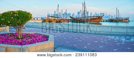 Morning Is The Best Time For The Lazy Walk In Doha Harbor, Enjoying The Beautiful Flower Beds, Old W