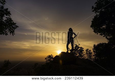 Girl Watching Sunset After Hike. Hiker Observing Purple And Orange Sunset. Sunset In Nature. Hiking.