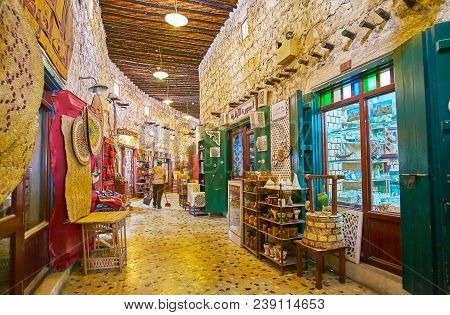 Doha, Qatar - February 13, 2018: The Curved Alley Of The Souq Waqif With Numerous Handicraft Stores