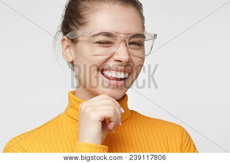 Closeup Headshot Of Beautiful European Student Girl Dressed In Mustard Turtleneck Sweater Isolated O