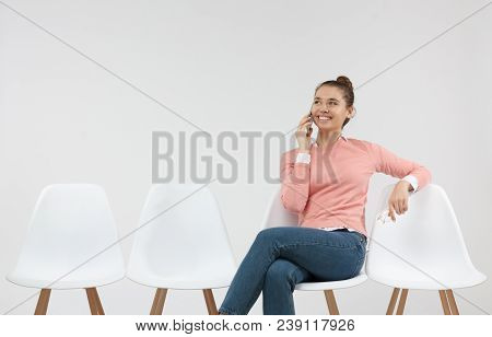 Young Caucasian Female Having Phone Conversation Sitting In The Line. People, Communication, Technol