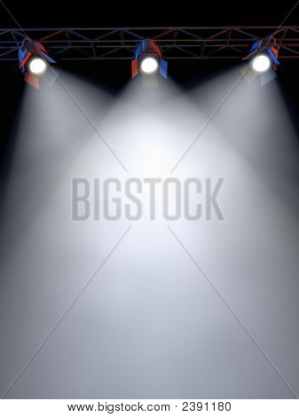 A Stage Light Rack with 3 Spotlights Shining down towards the middle of the layout in a dark area. poster