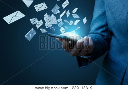 Businesswoman Works With Emails On A Blue Background.