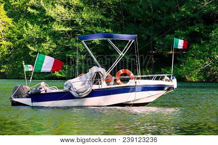 Boat On The Water, A Small Italian Boat, A Boat With The Flag Of Italy