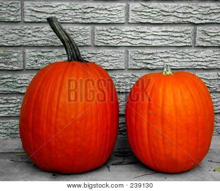 Two Glowing Pumpkins