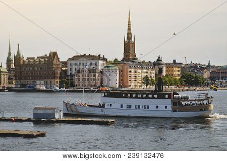 Stockholm, Sweden - July 2014: Tourist Boat Cruises By Stockholm's Old Town In Famous Gamla Stan Are