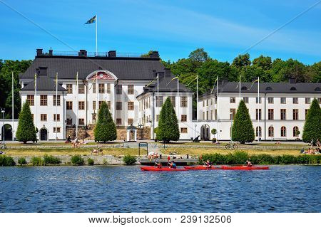 Stockholm, Sweden - July 2014: Tourists Kayaking Pass The Military Academy Karlberg At Karlberg Pala