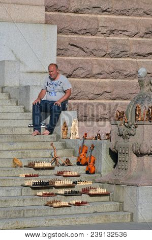 Stockholm, Sweden - July 2014: Street Vendor Selling Handmade Souvenirs At The Stairway In Famous To