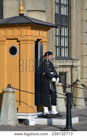 Stockholm, Sweden - July 2014: Female Stand Guard Stationed At The Royal Palace Of Stockholm, A Comb