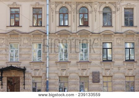 St. Petersburg, Russia - April 9, 2018: Ornamental Building Facade Decor With Windows Close Up View.