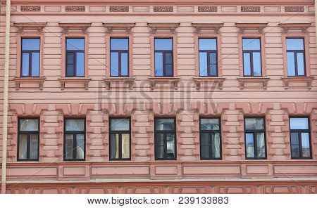 Classic Architecture Building Ornament Facade Of Old Historical House With Soft Red And Orange Color