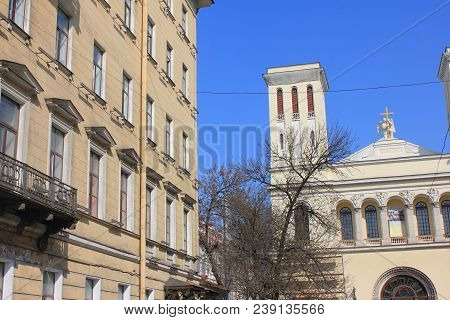 Lutheran Church of Saint Peter and Saint Paul in Saint Petersburg, Russia. Facade View of One of the Oldest and Largest Protestant Churches in Russia from City Center Street on Sunny Day. poster