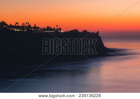 Long-exposure Shot Taken After Sunset Of Coastal Palos Verdes Estates With Silhouette Of Steep Cliff