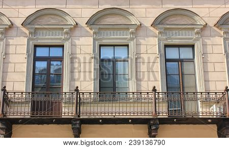 Building Facade With Cozy Balcony Of Old Historic House. Classic Old Town European Style Architectur