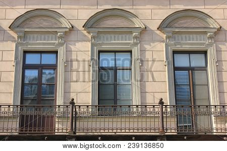 Balcony Of Old Historic Building With Simple Door Frame And Window Close Up View. Facade Architectur