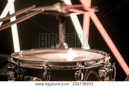 A Man Plays With Sticks On A Musical Percussion Instrument, Close-up. On A Blurred Background Of Col