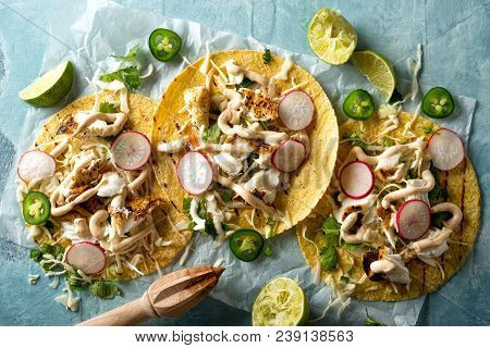 Delicious Tacos With Grilled Fish, Cilantro, Lime, Cabbage, Carrot, Jalapeno And Radish With Mexican