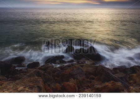 Amazing Sunset Along Point Dume State Beach With Colorful Sky, Waves Crashing Into Rock Formations,