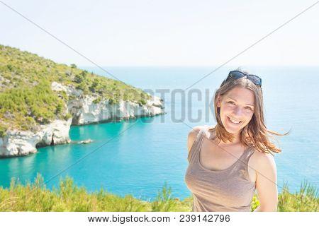 Apulia, Italy, Europe - Portrait Of A Smiling Woman At Grotta Della Campana Piccola