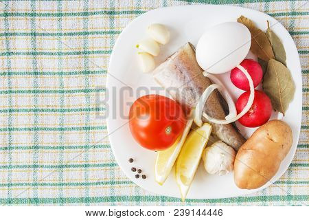 Fish and fresh organic vegetables on tablecloth. Uncooked foodstuffs for dish cooking. Natural food concept. Copy space. poster