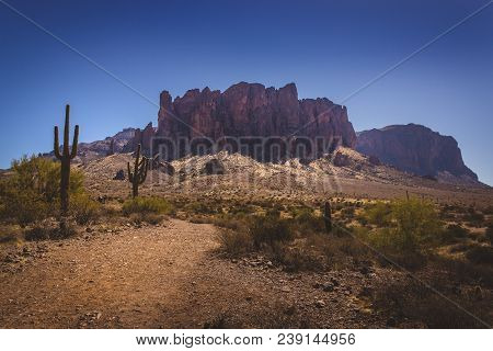 Iconic View Of Superstition Mountains And Saguaro Cacti In Lost Dutchman State Park, Arizona From Tr