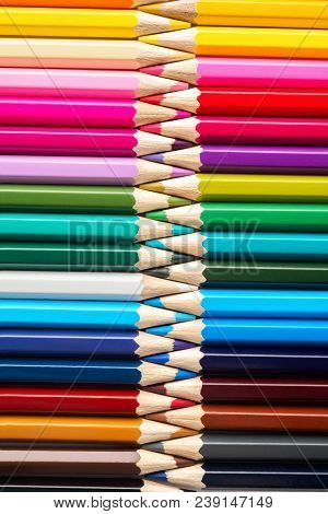 Set Of Colored Pastel Pencils In Row Multi Color In Form Of Closed Zipper And Pencil Sharpener Conce