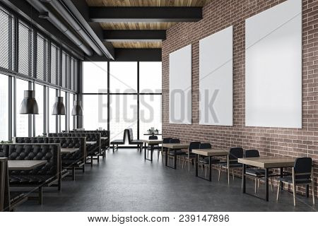Interior Of A Luxury Brick Restaurant With A Concrete Floor, Brick Walls And Comfortable Leather Sof