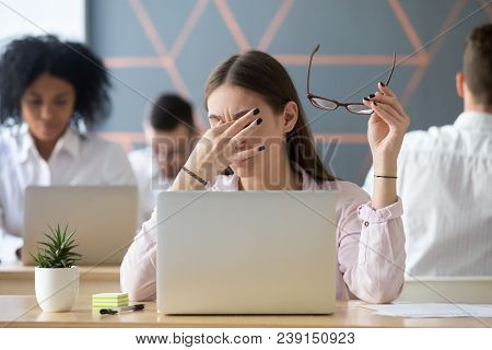 Young Woman Taking Off Glasses Tired Of Computer Work, Exhausted Student Or Employee Suffering From