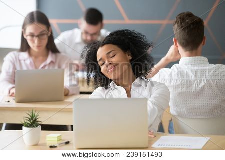 Relaxed Smiling African Woman Enjoying Break In Coworking, Happy Millennial Black Office Worker Or S