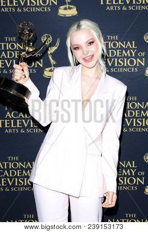 PASADENA - APR 27: Dove Cameron at the 45th Daytime Creative Arts Emmy Awards Gala at the Pasadena Civic Center on April 27, 2018 in Pasadena, California